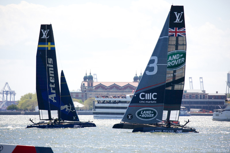 Sweden's Artemis Racing and Britain's Land Rover BAR work their way toward the crowd.